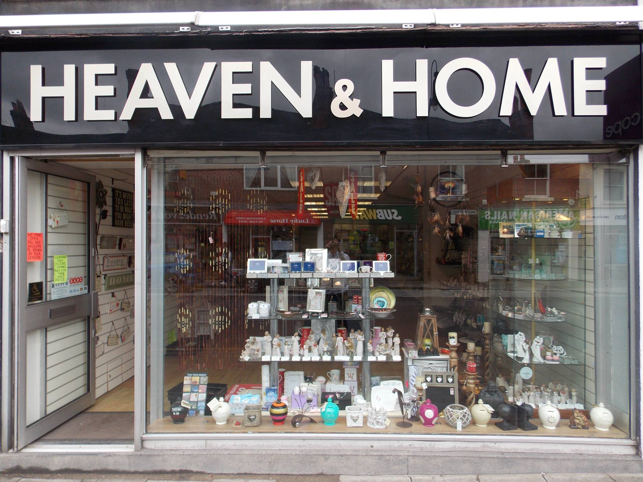The photo shows the shop front of Heaven and Home