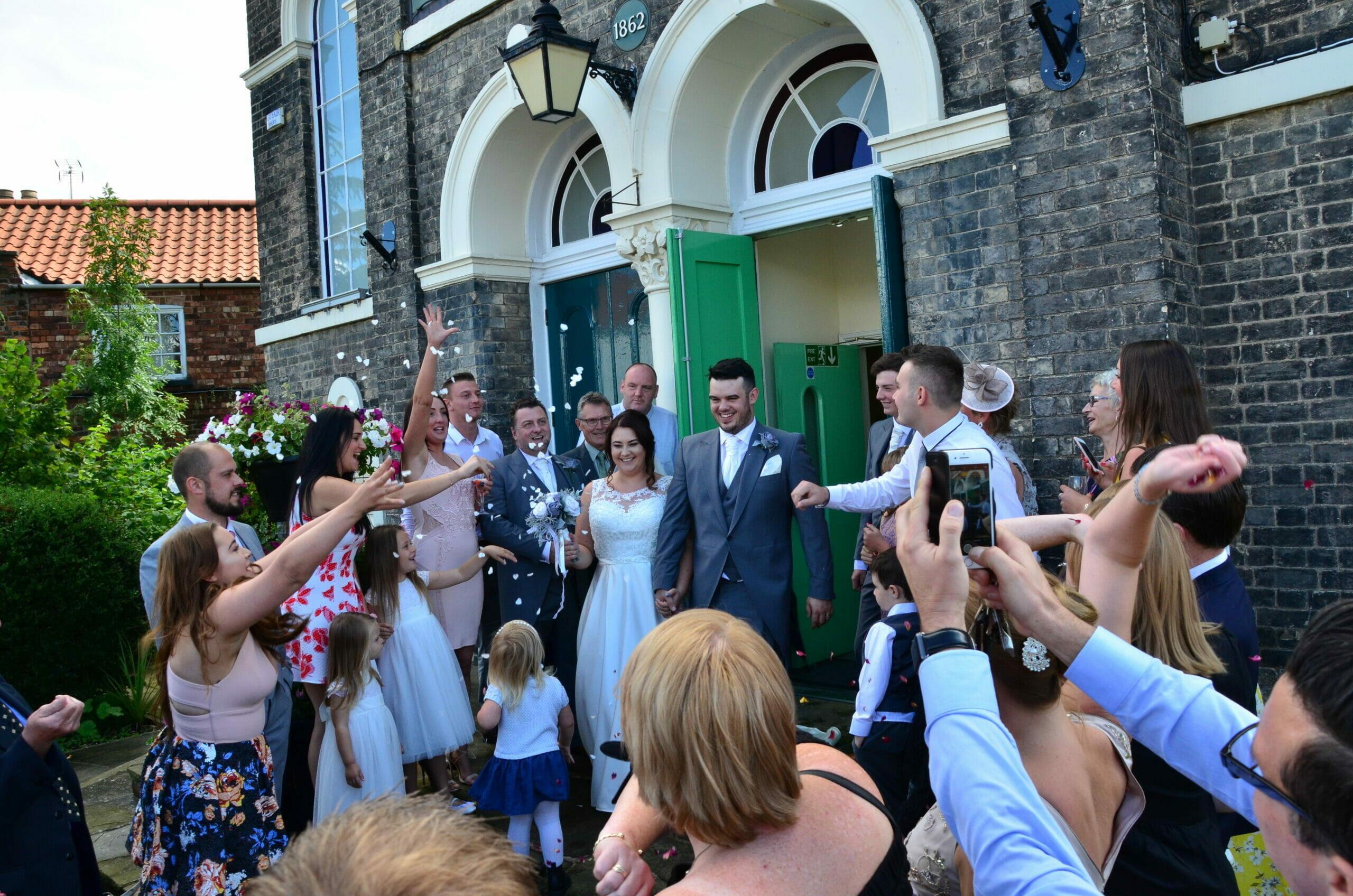 Photo shows a wedding couple on the front steps of the Town Hall