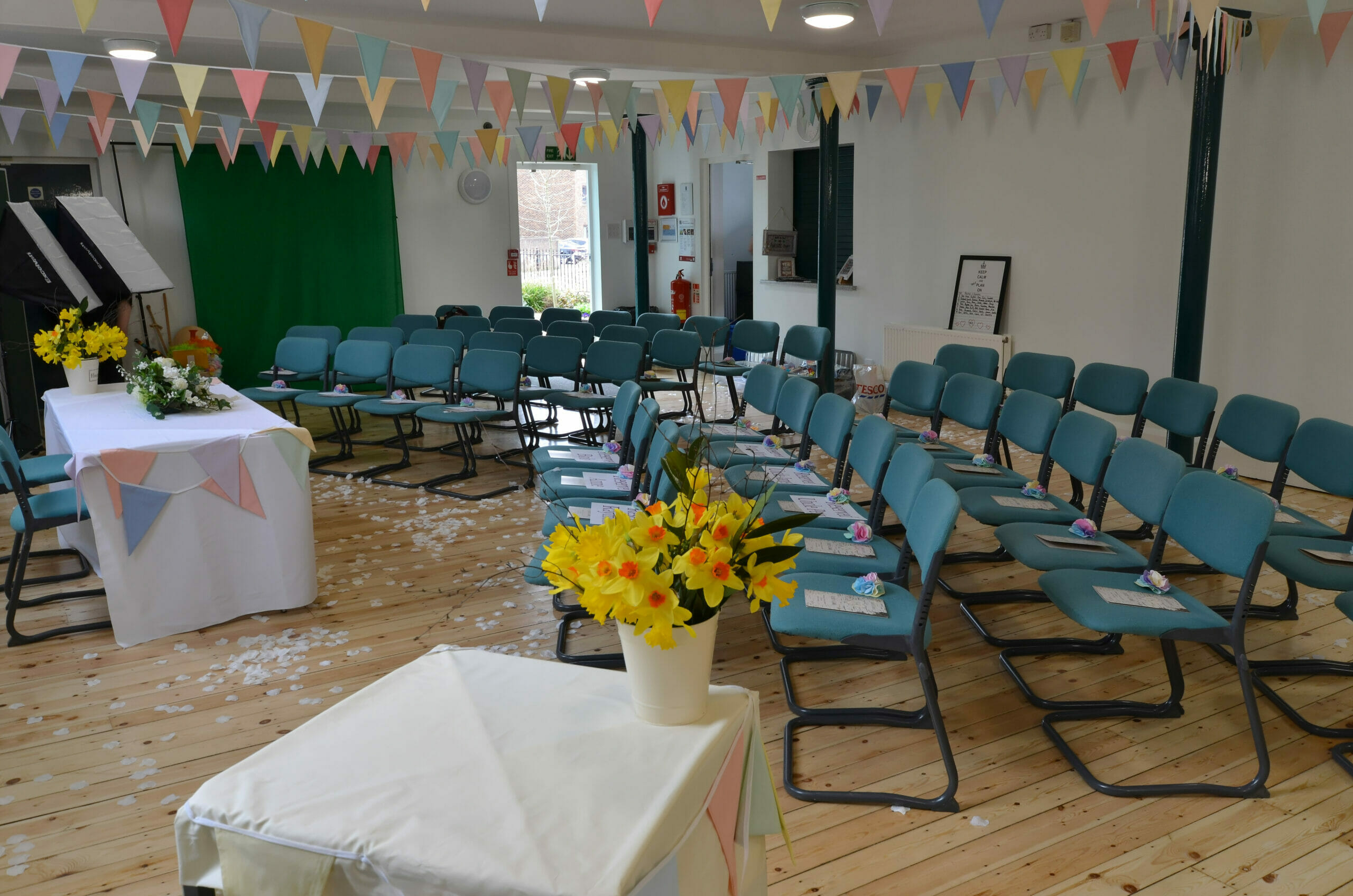 Photo shows a room layout with chairs and bunting