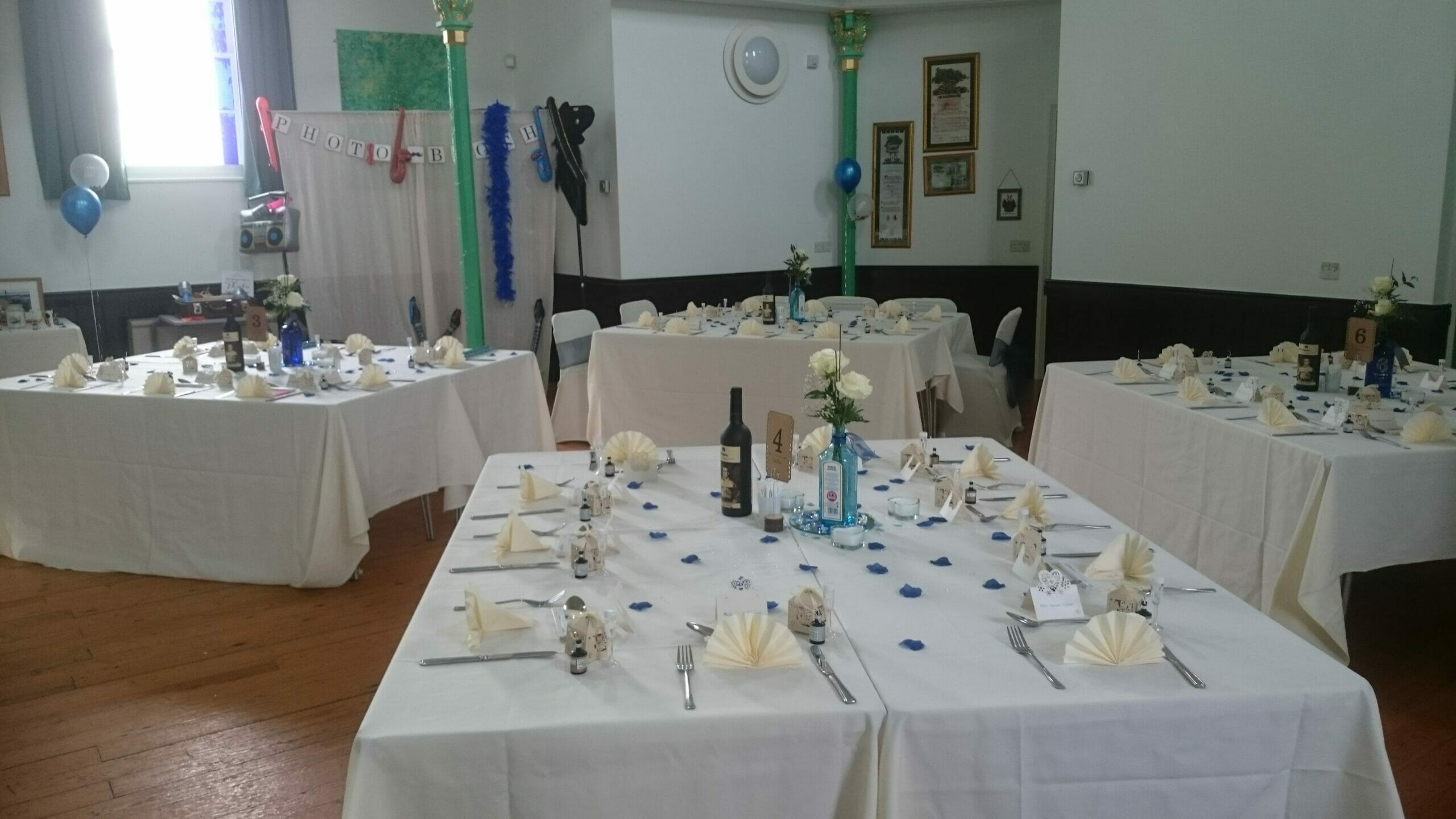 Photo shows a room layout with square tables